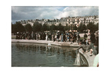 A Crowd Watches Little Boys Have Small Boat Races in a Pond Photographic Print by W. Robert Moore