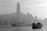 Hong Kong Skyline with Boats in Victoria Harbor in Black and White. Photographic Print by Songquan Deng
