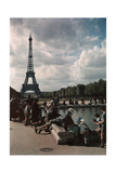 A Crowd Watches Children Sail Boats in a Pond Near the Eiffel Tower Photographic Print by W. Robert Moore