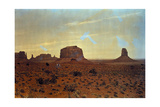 A Sunlit View of Monument Valley, Rises Up on the Utah-Arizona Border Photographic Print by Edwin L. Wisherd