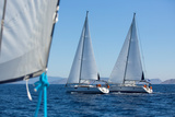 Sailing Ship Yachts with White Sails in a Row. Photographic Print by De Visu