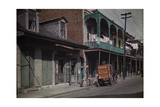 A Boy Sits on a Barrel Outside a Brewery in the French Quarter Photographic Print by Edwin L. Wisherd