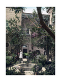 A Lush Garden Courtyard in a Home of Islamic Architecture Photographic Print by John D. Whiting