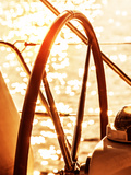 Image of Sailboat Helm on Sunset, Steering Wheel of Yacht, Rudder of Vessel on Sunrise, Sea Transpo Posters by Anna Omelchenko