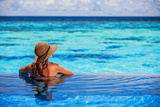 Relaxing on Beach Resort, Back Side of Sexy Woman Enjoying Seascape from Endless Pool, Luxury Summe Photographic Print by Anna Omelchenko
