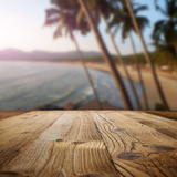 Wooden Table on the Beach with Palms Photographic Print by  ZoomTeam
