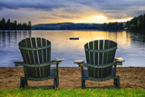 Two Wooden Chairs on Beach of Relaxing Lake at Sunset. Algonquin Provincial Park, Canada. Photographic Print by  elenathewise