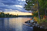 Dramatic Sunset and Pines at Lake of Two Rivers in Algonquin Park, Ontario, Canada Fotografisk tryk af  elenathewise