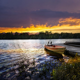 Rowboat Tied to Dock on Beautiful Lake with Dramatic Sunset Posters by  elenathewise