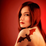 Photo of Beautiful Sexy Girl with Bat Tattoo on Shoulder Isolated on Red Background, Halloween Holi Photographic Print by Anna Omelchenko