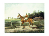 A Chestnut Racehorse with Jockey Up on a Training Track with Stables Beyond Giclee Print by Henry H. Cross