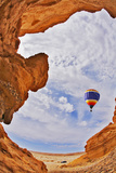The Balloon Flies above a Picturesque Slot-Hole Canyon in Desert Photographic Print by  kavram