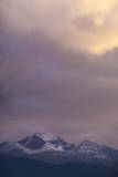 Clouds Lit by Setting Sun Above Rocky Mountains Ridge Photographic Print by Anna Miller