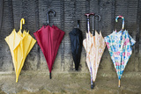Colorful Umbrellas Leaning against a Wall Prints by  Nosnibor137