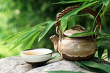 Teapot and Cups on Stone with Bamboo Leaves. Print by Liang Zhang