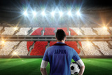 Japan Football Player Holding Ball against Stadium Full of Japan Football Fans Photographic Print by Wavebreak Media Ltd