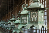 Japanese Style Bronze Lantern Hanging up in the Shrine of  Kasuga Taisha in Nara, Japan. Photographic Print by  elwynn
