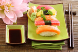 Japan Traditional Food Sushi on Green Plate Photographic Print by  egal
