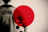 Japan Football Player Holding Ball against Japan National Flag Photographic Print by Wavebreak Media Ltd