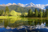 Gorgeous Reflection in the Smooth Water of the Lake in the Park.  Snowy Mountains and Evergreen For Photographic Print by  kavram