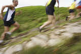 Side View of Blurred Group of People Running on Track Photographic Print by  Nosnibor137