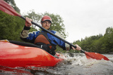 Low Angle View of a Young Man Kayaking in River Photographic Print by  Nosnibor137