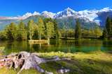 City Park in the Alpine Resort of Chamonix. Cold Lake Surrounded by Trees and Snow-Capped Mountains Photographic Print by  kavram
