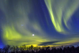Northern Lights (Aurora Borealis) over Snowscape. Photographic Print by Jorg Hackemann