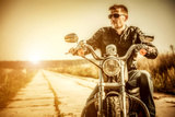 Biker Man Sits on a Bike Photographic Print by Andrey Armyagov