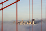 San Francisco in Fog through Golden Gate Bridge. Photographic Print by Guy Vanderelst