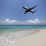 Airplane Flying over a Deserted Beach Photographic Print by Buena Vista Images