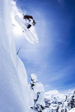 Skier Jumping on Snowy Slope Photographic Print by Jakob Helbig