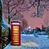 Red Phone Box Covered in Snow Photographic Print by Photo by John Quintero