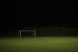 Empty Soccer Field at Night. Photographic Print by Tom Roberton