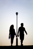 Couple Exercise While Walking at Sunset Photographic Print by Virginia Star
