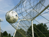 Football Trapped in a Goal Net Photographic Print by Datacraft Co Ltd