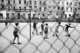 Playing Football Photographic Print by Thurston Hopkins