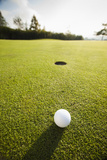 Usa, California, Mission Viejo, Golf Ball on Grass Photographic Print by Erik Isakson