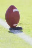 American Football on Kicking Tee. Photographic Print by David Madison