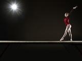Female Gymnast Balancing on Beam Photographic Print by Mike Harrington