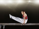 Young Male Gymnast Performing on Parallel Bars Photographic Print by Robert Decelis Ltd