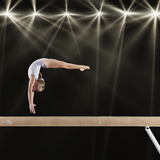 Young Female Gymnast on Balance Beam Papier Photo par Robert Decelis Ltd