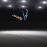 Female Gymnast Jumping through Air Photographic Print by Robert Decelis Ltd