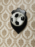 Punctured Football Hanging as a Trophy on a Wall Photographic Print by Henrik Sorensen