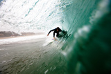 A Male Surfer Pulls into a Barrel While Surfing at Zuma Beach in Malibu, California. Photographic Print by Kyle Sparks