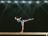 Gymnast Performing Routine on Balance Beam Photographic Print by Robert Decelis Ltd
