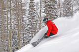 Snowboarder Enjoying Deep Fresh Powder at Brighton Ski Resort. Photographic Print by Paul Kennedy