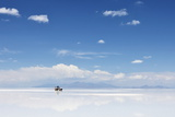 4Wd in the Moiddle of Salar De Uyuni, Salt Flat in Bolivia Photographic Print by  zanskar