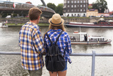 Young Couple on a Journey to Europe, Standing on the Bank of the Vistula, Rear View. Photographic Print by De Visu