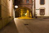 Mysterious Narrow Alley with Lanterns in Krakow at Night Photographic Print by  dziewul